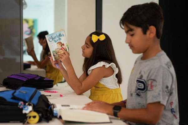 Alina and Aryan Magon often use the kitchen counter to work on their homework in their Piney Point Village home.