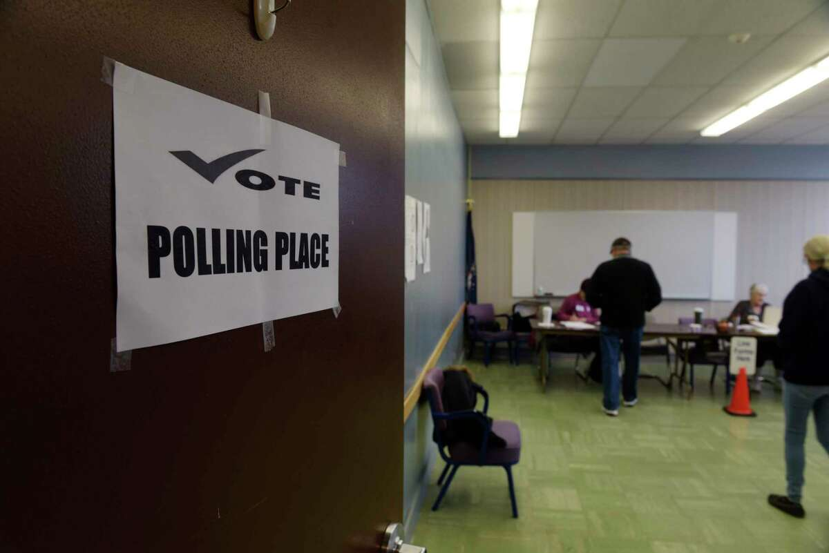 Voters make their way into the polling station inside Rensselaer City Hall on Tuesday morning, Nov. 7, 2017, in Rensselaer, N.Y. (Paul Buckowski / Times Union)