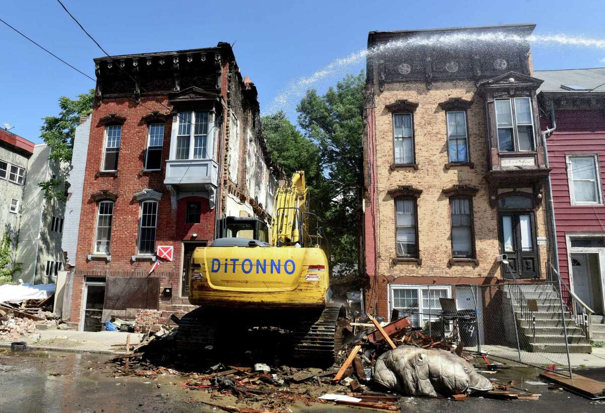 42 Lexington Avenue is demolished on Tuesday, June 23, 2020, at the corner of Clinton Avenue in Albany, N.Y. The buildings to the left and right, 40 and 44, will remain. Number 38 Lexington was also taken down. (Will Waldron/Times Union)