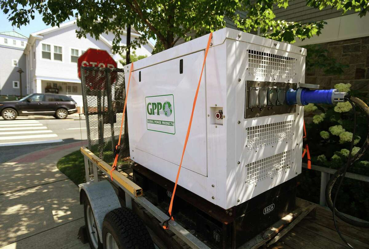 A generator powers a business in the aftermath of a Tropical Storm Isaias in the still dark Saugatuck section of Westport, Conn. on Monday, August 10, 2020.