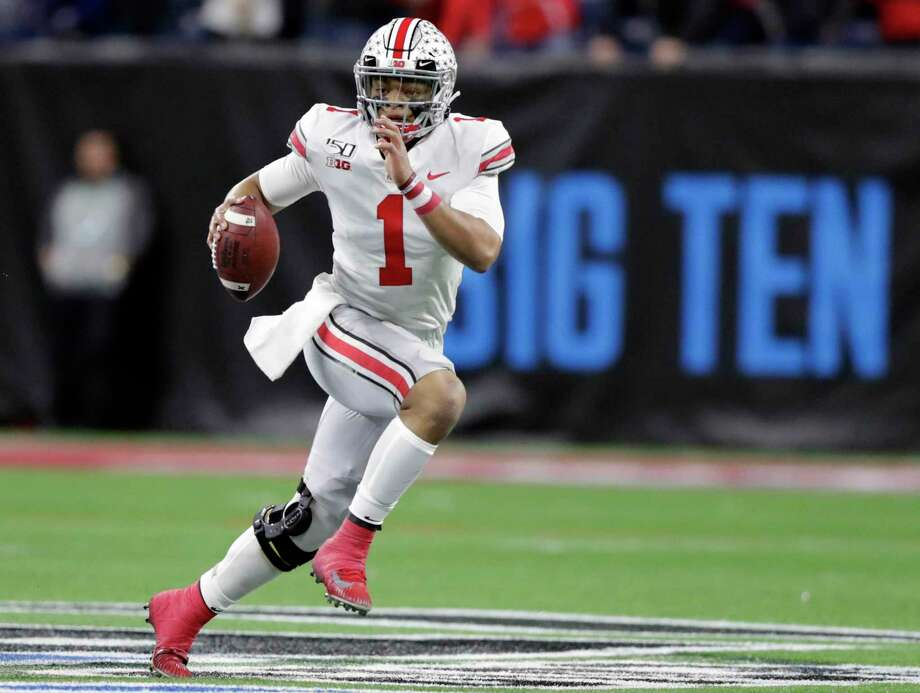 Ohio State quarterback Justin Fields was one of several players pushing to play college football this season. Photo: Michael Conroy, STF / Associated Press / Copyright 2019 The Associated Press. All rights reserved.