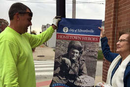 In this November 2019 file photo, the pair admires one of the dozens of commemorative banners hung in honor of area veterans in downtown Edwardsville.