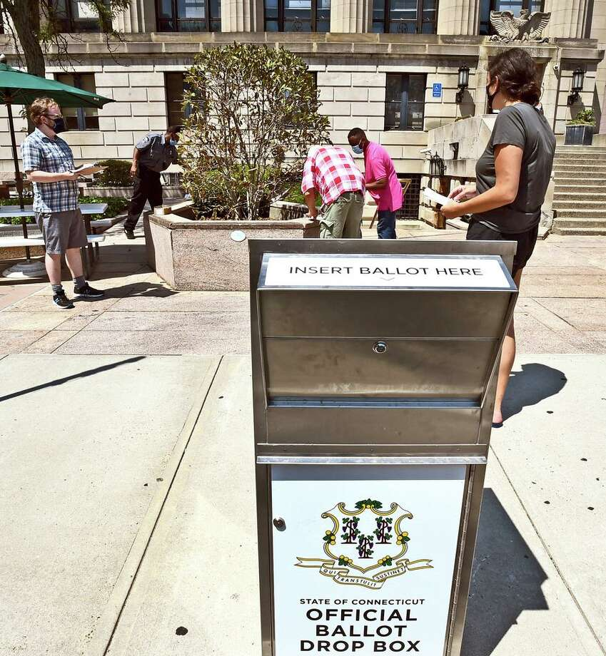 In this file photo, an absentee ballot box sits in front of the Hall of Records at 200 Orange St., New Haven in August. Photo: Peter Hvizdak / Hearst Connecticut Media File Photo / New Haven Register