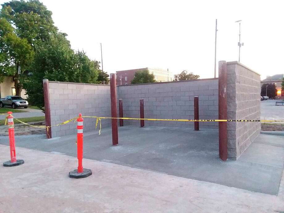 This dumpster corral was construction was nearing completion in the city on Water Street on July 30.Manistee City Council approved two dumpster corrals in April to be built to help with trash collection and aesthetics of refuse collection downtown. (Michelle Graves/News Advocate)