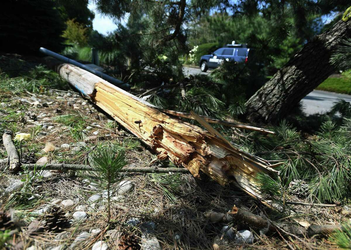 A shredded power pole in the aftermath of a Tropical Storm Isaias tornado at 9 Surf Road in Westport, Conn. on Monday, August 10, 2020.