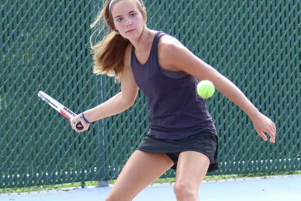 Alton senior Paige Rockholm hits a forehand return during a drill Monday afternoon at the Alton High tennis courts in Godfrey on the opening day for fall sports in Illinois.