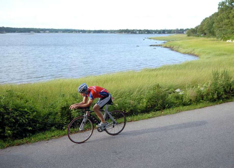 Triathlete Peter Mullen of Riverside, on his bike at Greenwich Point, Thursday, August 26, 2010.  Mullen will be competing in the Ford Ironman World Championship at Kona, Hawaii on October 9, 2010. Photo: Bob Luckey / Greenwich Time