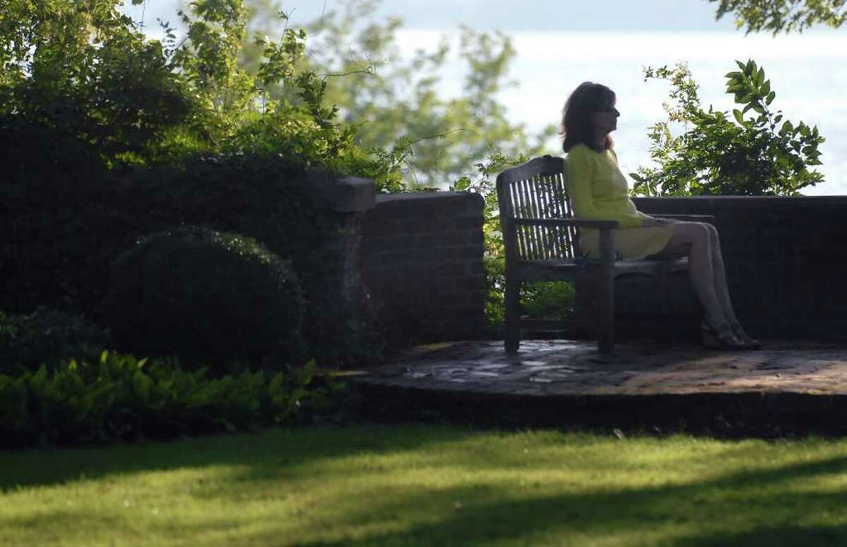 """Rosina Primo of Riverside gets her 15 minutes of meditation in at the Secret Garden, Greenwich Point, Thursday August 26, 2010. Primo who said she likes to get in four visits to Greenwich Point and the garden per week said, """"This beats Cannes. The beauty, the quiet, the rustling of the trees. It is a wonderful place."""""""