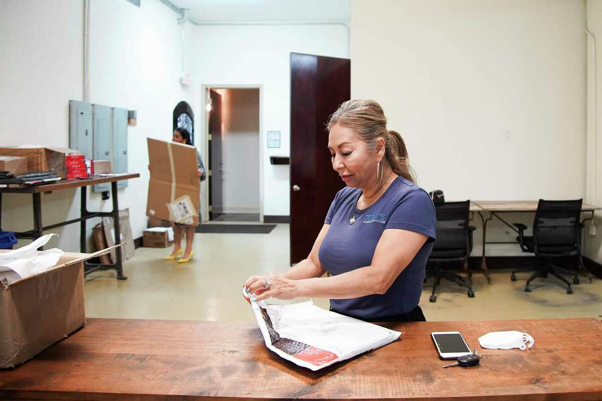 Mely Jimerez works in her business, Today's Business Solutions, in Houston on Monday, Aug. 10, 2020. The family-run business had to lay off all their employees as they try to stay afloat during these times.