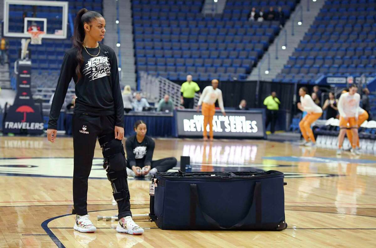 Connecticut's Evina Westbrook, a transfer from Tennessee watches her team stretch before an NCAA women's basketball game on Jan. 23 in Hartford, Conn.