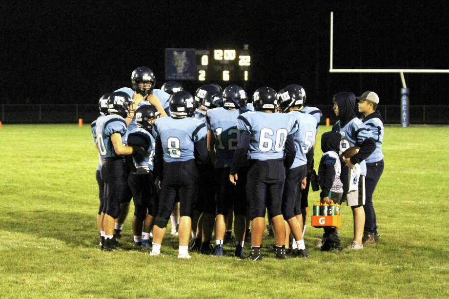 The Brethren Bobcats huddle up during a game last season. Football practice officially started in Michigan on Monday, but the season is still in question due to the COVID-19 pandemic. (News Advocate file photo)
