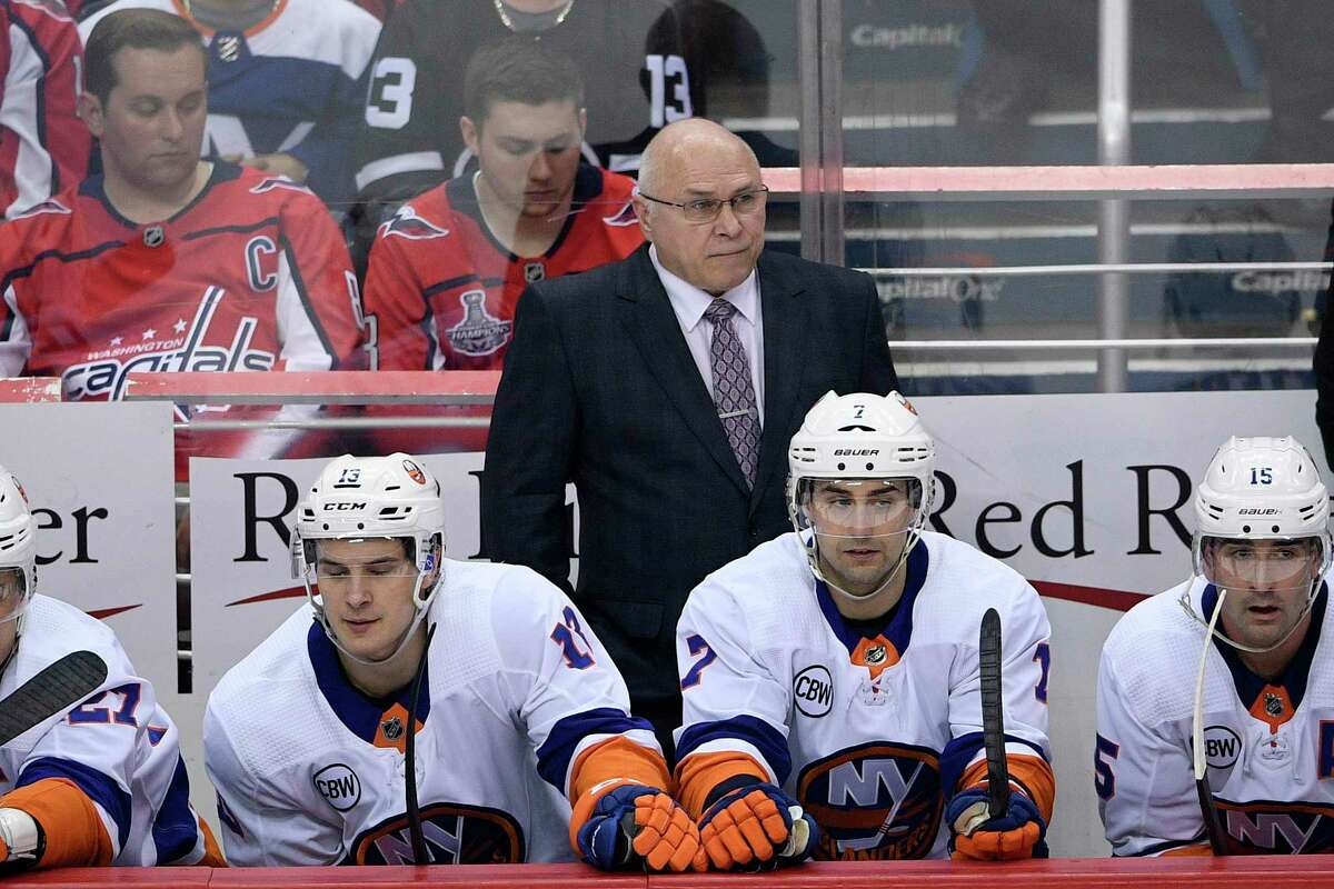 FILE - In this April 6, 2019, file photo, New York Islanders head coach Barry Trotz, top center, watches from the bench during the third period of an NHL hockey game against the Washington Capitals, in Washington. Trotz faces a familiar foe with New York preparing to open the first round against his former team, the Washington Capitals. (AP Photo/Nick Wass, File)