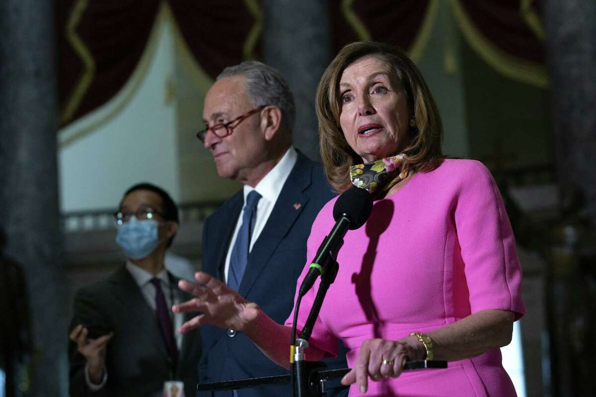 Senate Minority Leader Chuck Schumer, a Democrat from New York, center, listens as U.S. House Speaker Nancy Pelosi, a Democrat from California, speaks to members of the media following a meeting at the U.S. Capitol in Washington, D.C., U.S., on Friday, Aug. 7, 2020. No agreement on a final deal has been reached, after U.S. Treasury Secretary Steven Mnuchin told reporters an offer from Democrats to come down by $1 trillion for a stimulus deal is