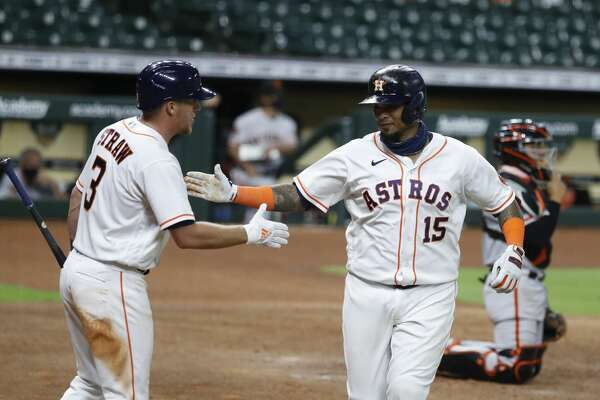 Houston Astros Martin Maldonado celebrates with Myles Straw after hitting a solo home run during the sixth inning of an MLB baseball game at Minute Maid Park, Monday, August 10, 2020, in Houston.