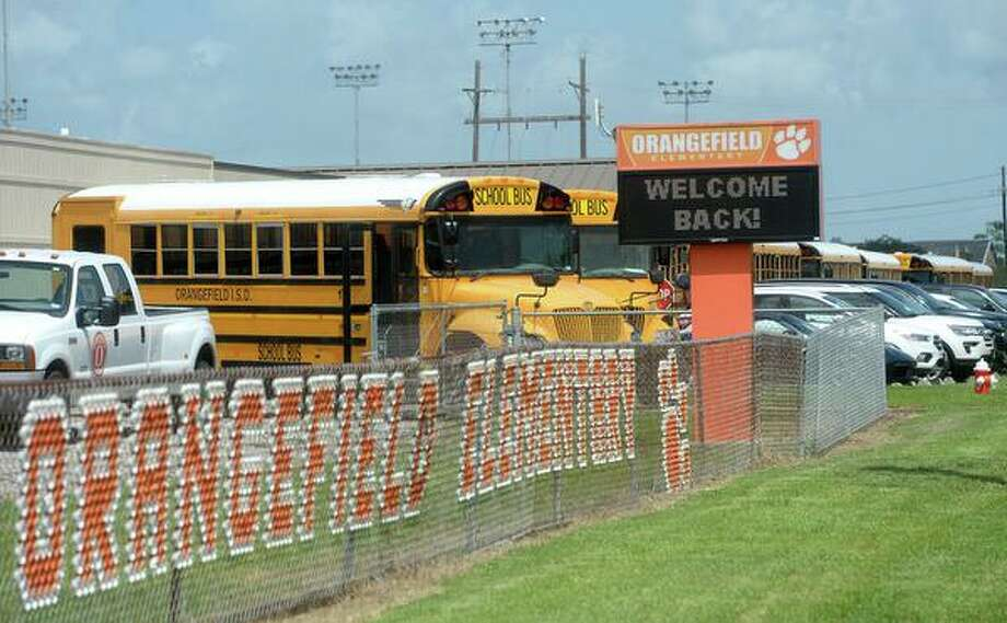 A line of buses and cars wait for student pick-up at the end of the first day back to school for Orangefield students. Photo taken Monday, August 10, 2020 Kim Brent/The Enterprise Photo: Kim Brent/The Enterprise