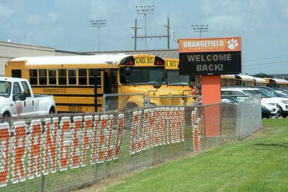 A line of buses and cars wait for student pick-up at the end of the first day back to school for Orangefield students. Photo taken Monday, August 10, 2020 Kim Brent/The Enterprise