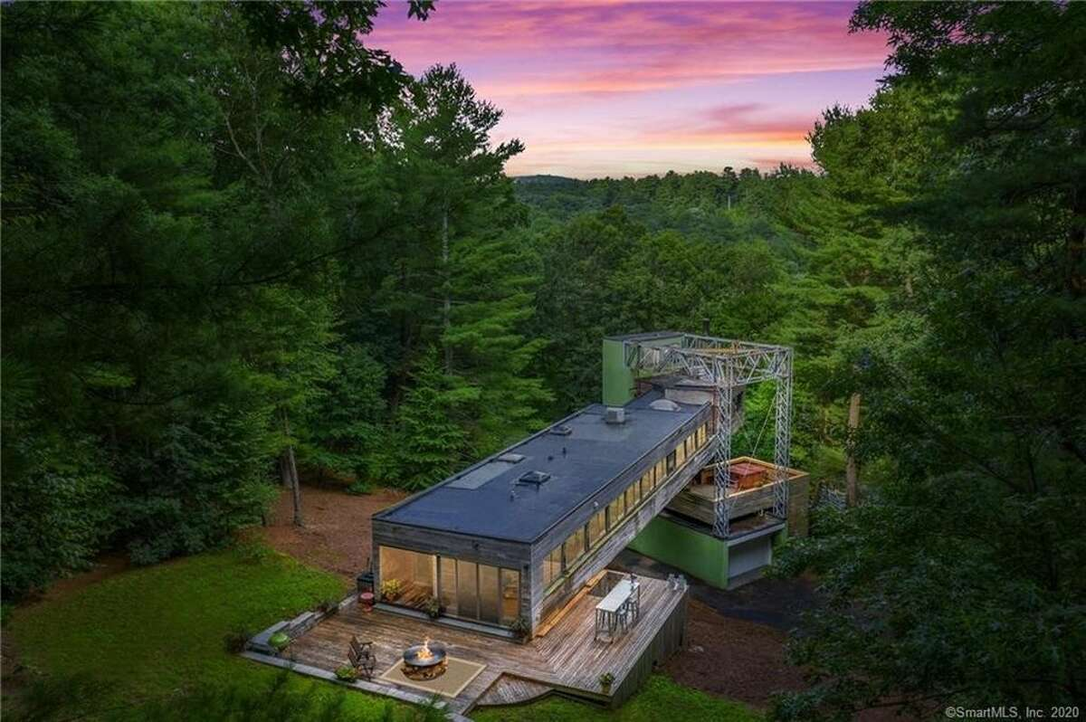 It's a bit of a bridge to nowhere, but this journey resulted in a truly unique house. The cedar bridge house on Manchester Road in Glastonbury, CT, sits 50 feet above ground, anchored to a steel support structure. It's on the market for only the second time, listed for $530,000.