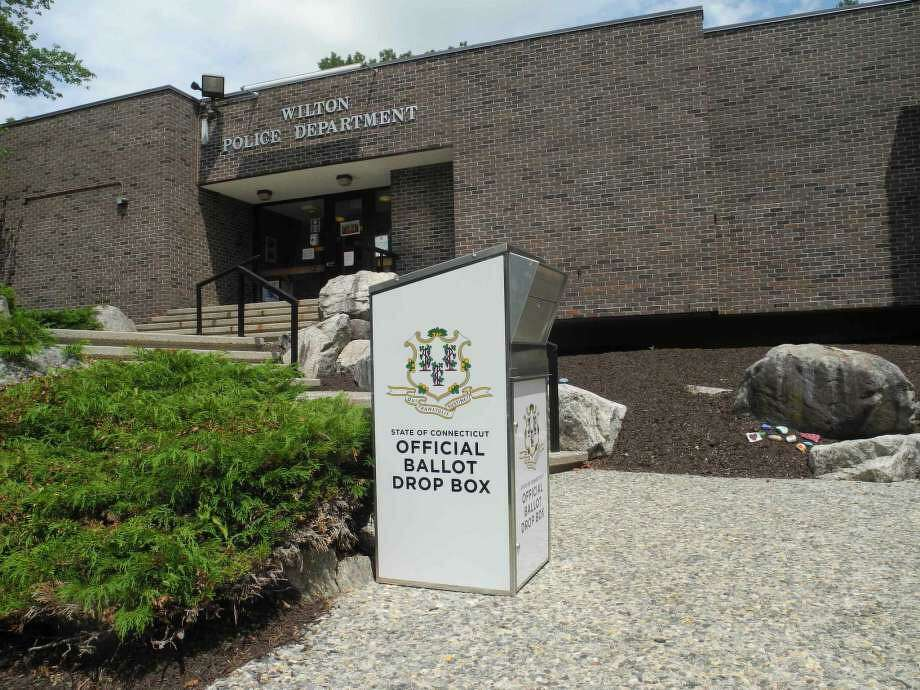 For Tuesday's Presidential Preference Primary, absentee ballots can be placed in the drop box outside the Wilton Police Department until the polls close at 8 p.m. Voters can also submit their absentee ballots by mail and they will count as long as they are postmarked by Tuesday, Aug. 11 and received by the registrars by Thursday, Aug. 13. Photo: Jeannette Ross /Hearst Connecticut Media