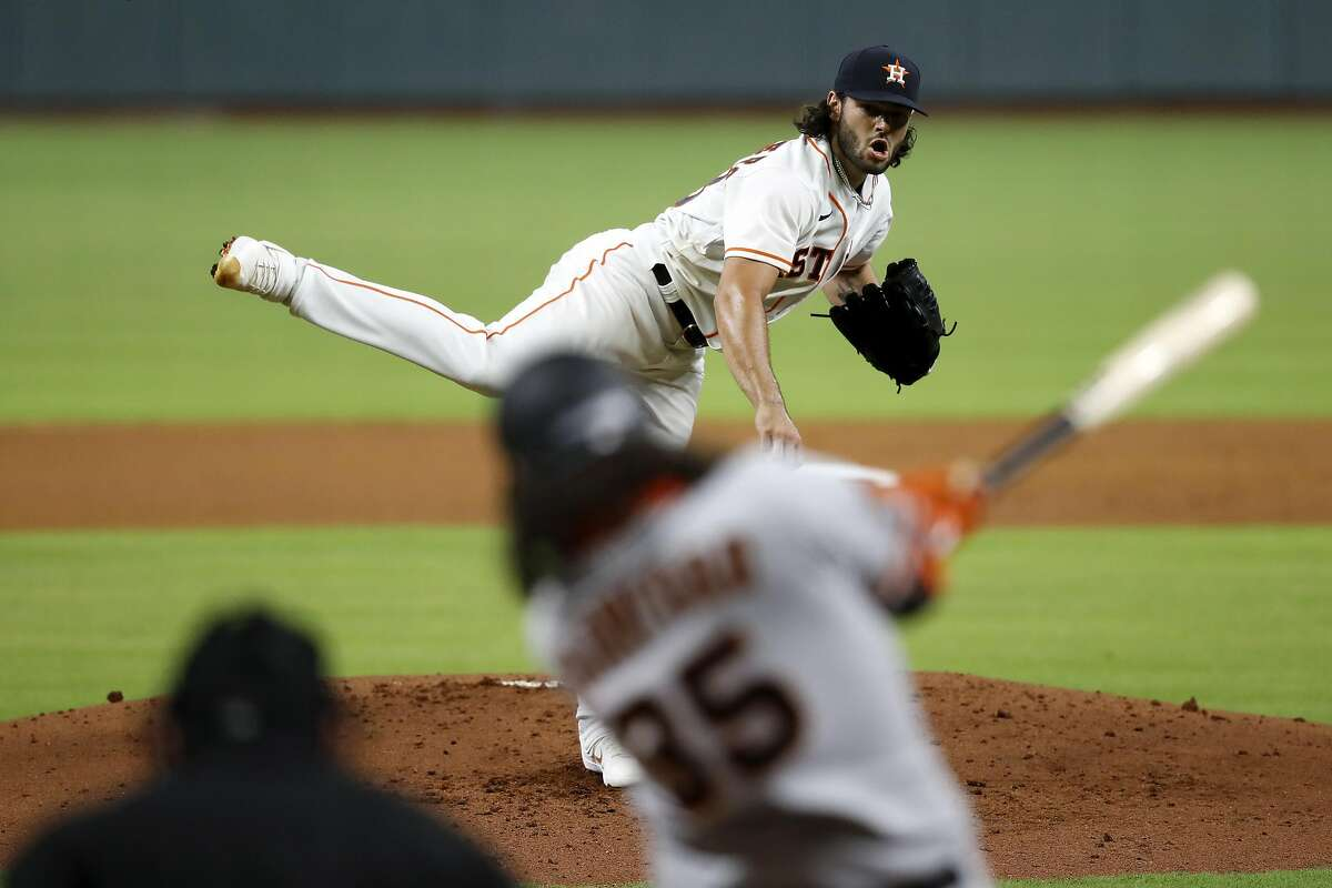 HOUSTON, TEXAS - AUGUST 10: Lance McCullers Jr. #43 of the Houston Astros pitches to Brandon Crawford #35 of the San Francisco Giants in the second inning at Minute Maid Park on August 10, 2020 in Houston, Texas. (Photo by Tim Warner/Getty Images)