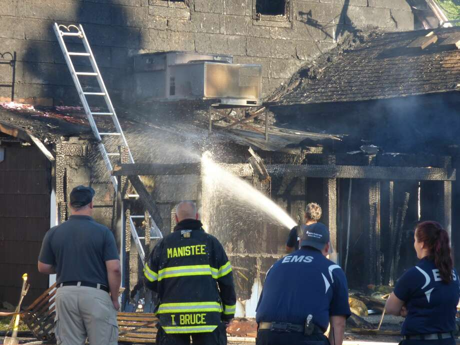 The Hi-Way Inn on Kosciusko Street in Manistee caught fire early this morning. Firefighters from five departments were still on the scene at 8 a.m. Photo: Scott Fraley/News Advocate