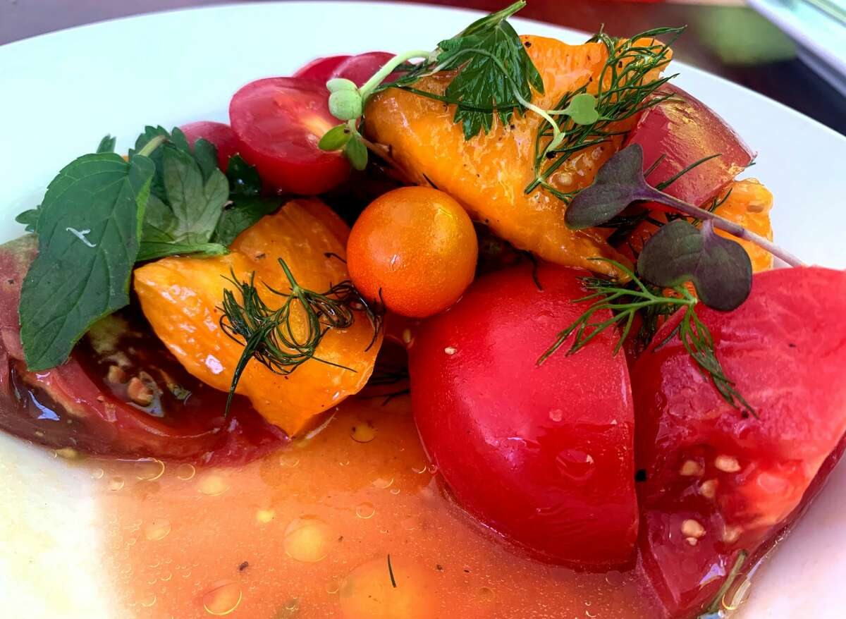 Heirloom tomato salad from the new menu at the newly reopened New World Bistro Bar in Albany.