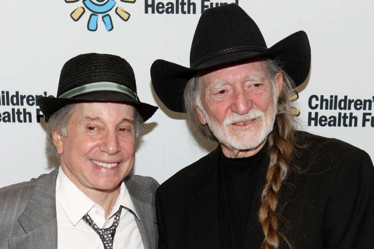 Recording artists Paul Simon and Willie Nelson attend the Children's Health Fund benefit at the Sheraton New York Hotel & Towers on May 27, 2009 in New York City.