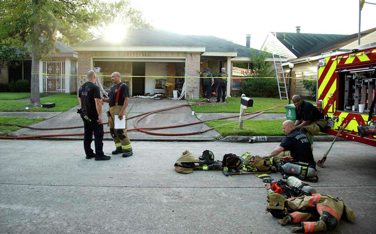 Houston Fire Department investigates a fatal fire in a group home for adults with special needs in Houston on Tuesday, Aug. 11, 2020.