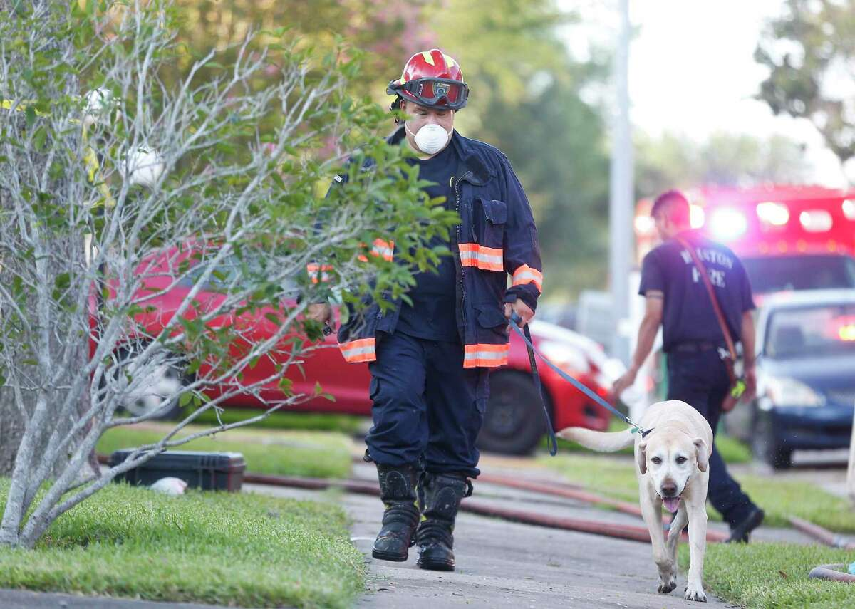 Houston Fire Department investigates a fatal fire in a home for adults with special needs in the 6100 block of Gladewell in Houston on Tuesday, Aug. 11, 2020.