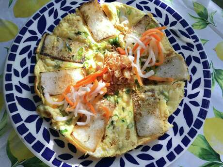 Banh Bot Chien with rice cake, fried shallots and house pickle from Kau Ba Saigon
