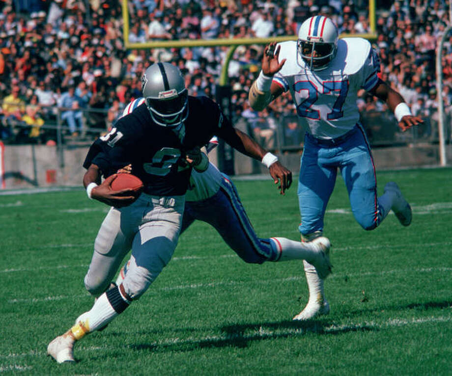 Edwardsville graduate Morris Bradshaw, left, played eight of his nine seasons in the NFL with the Oakland Raiders. He later spent 28 years in the Raiders' front office. Photo: Las Vegas Raiders Archives