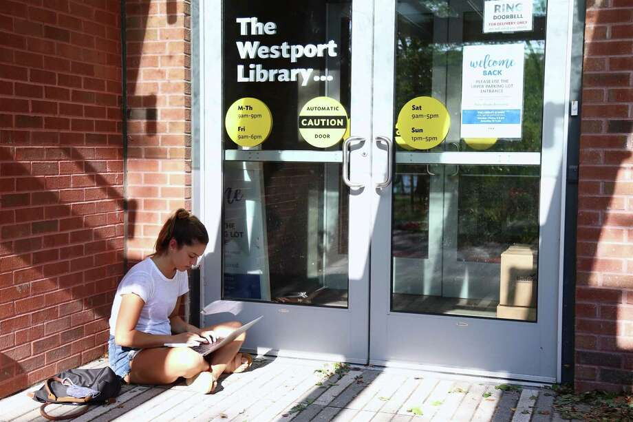 Taylor Githens of Westport couldn't go to the library, but did the next best thing on Wednesday, Aug. 5, 2020, in Westport, Conn. Photo: Jarret Liotta / Jarret Liotta / ©Jarret Liotta 2020