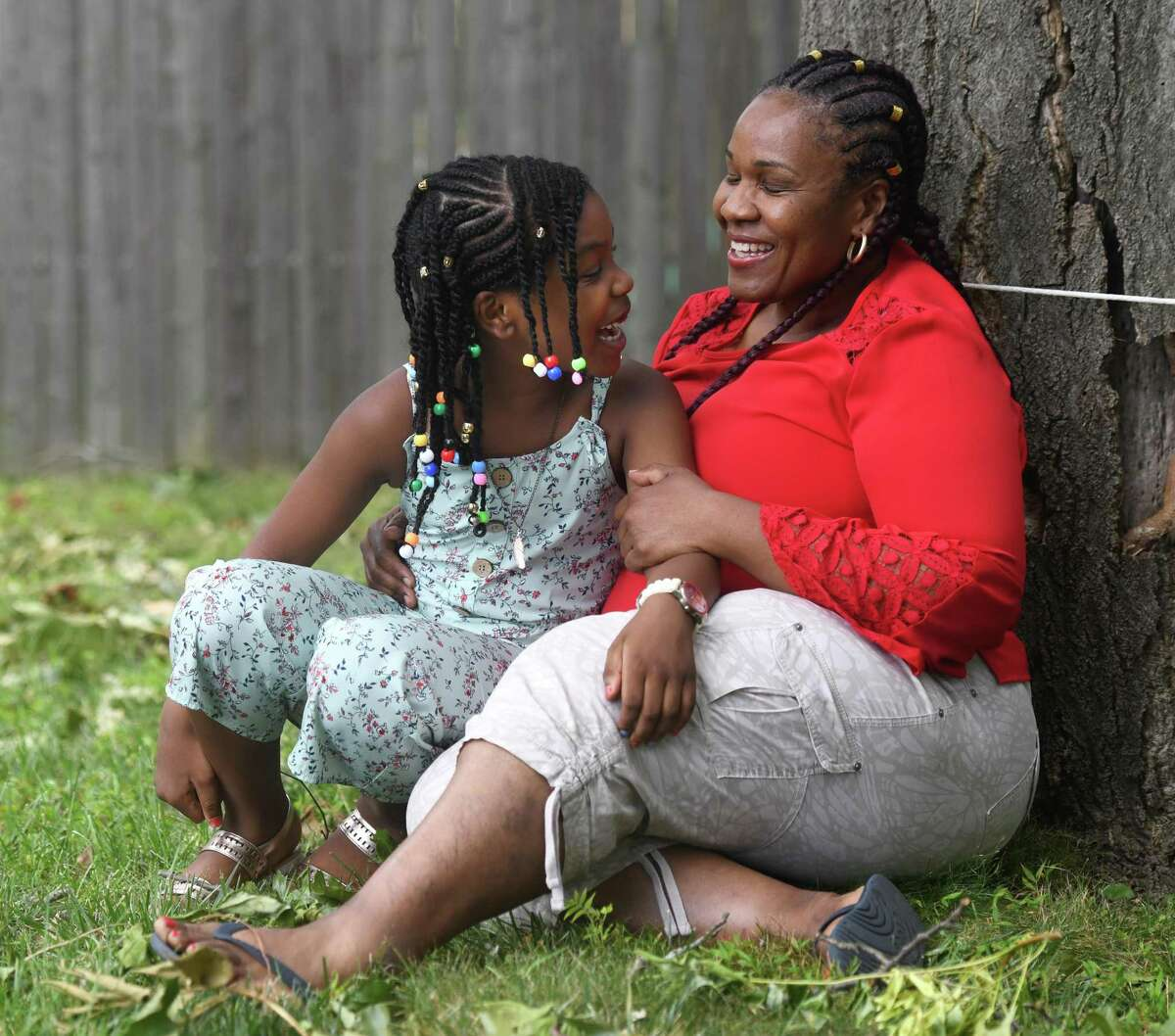 Ghislaine Germain poses with her daughter, Regina Renodo, 7, at their home in Stamford, Conn. Thursday, Aug. 6, 2020. Renodo was rescued from drowning off West Beach by a police officer and emergency room nurse in early July.