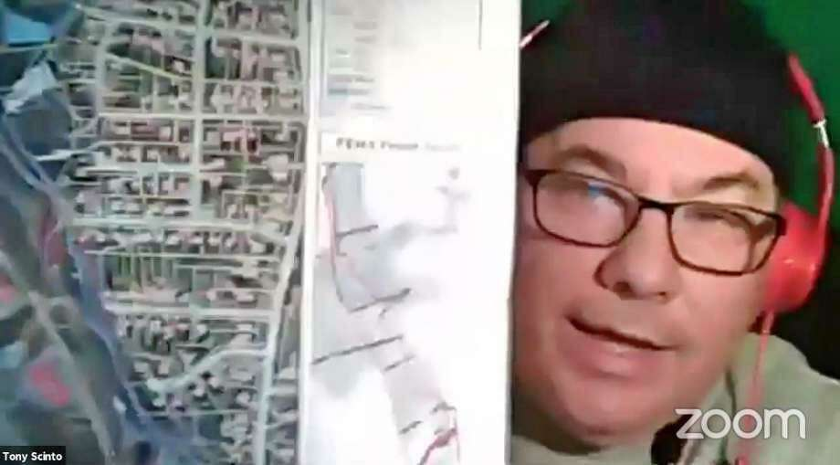 Town council member Tony Scinto holds up a flood map he says shows the Pequonnock River misleadingly close to his house during the May 9 2020 meeting of the Redistricting Committee. Photo: Zoom Screen Capture