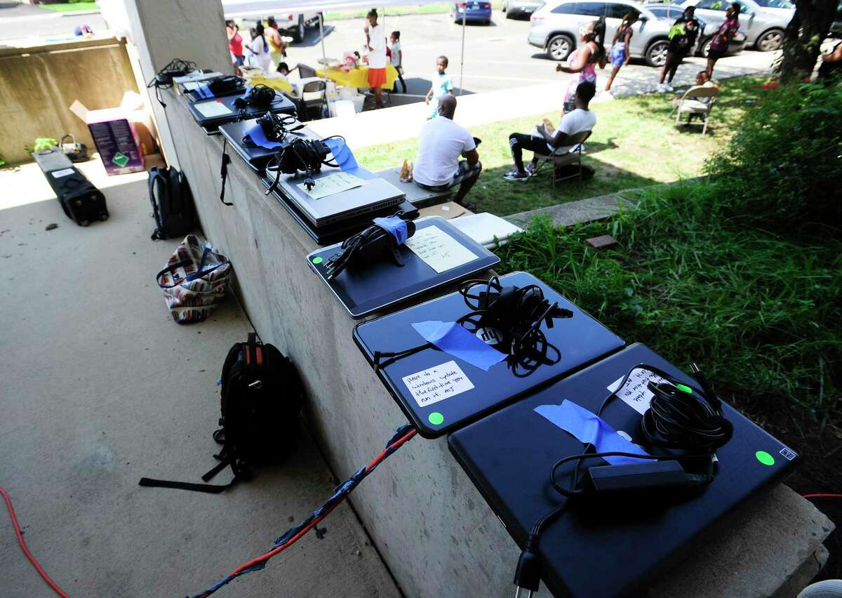 Used laptops wait to be checked and serviced as needed during the 2020 Stamford Community Laptop Drive on Saturday, August 8, 2020 in Stamford, Connecticut. Organizers procured over 200 hundred new and refurbished laptops from local businesses, as well as receiving community donated laptops that technicians cleaned, updated/installed software on-site, that would be redistributed for children in need and without access to a computer. The event was co-sponsor by the Stamford Police Department, YES ( Youth Employment Show), Sunshine Cuisine and Stamford Alumni from Kappa Alpha Psi fraternity. Stamford Public Schools announced last week plans for a Hybrid Learning, where students will receive two days of in classroom instruction and three days of continued Virtual Distance Learning, in an effort to continue the fight against the spread of Covid-19.