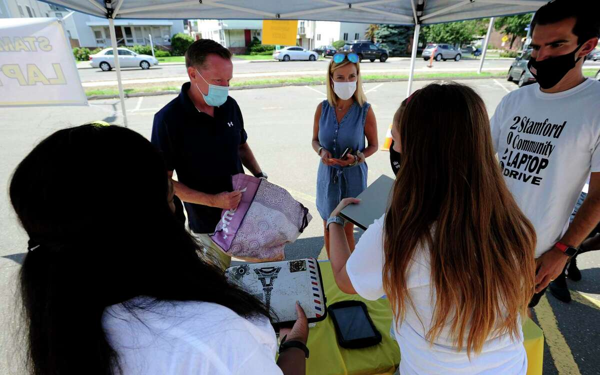 Stamford Police Chief Timothy Shaw and his wife Nancy drop off used laptops that he acquired from family and neighbors during the 2020 Stamford Community Laptop Drive on Saturday, August 8, 2020 in Stamford, Connecticut.