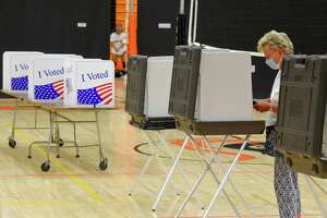 Jean Kulbieda of Stamford casts her vote in the last presidential primary prior to the November Elections, at the Polling Station for District #5 at Stamford High School on August 11, 2020 in Stamford, Connecticut.