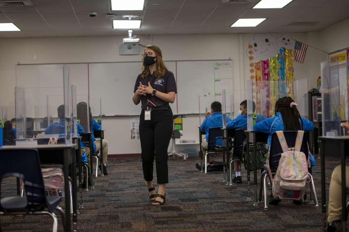 Third and fourth grade teacher Kaylan Merring talks to her students about social distancing Tuesday, Aug. 11, 2020 at IDEA Travis Academy.