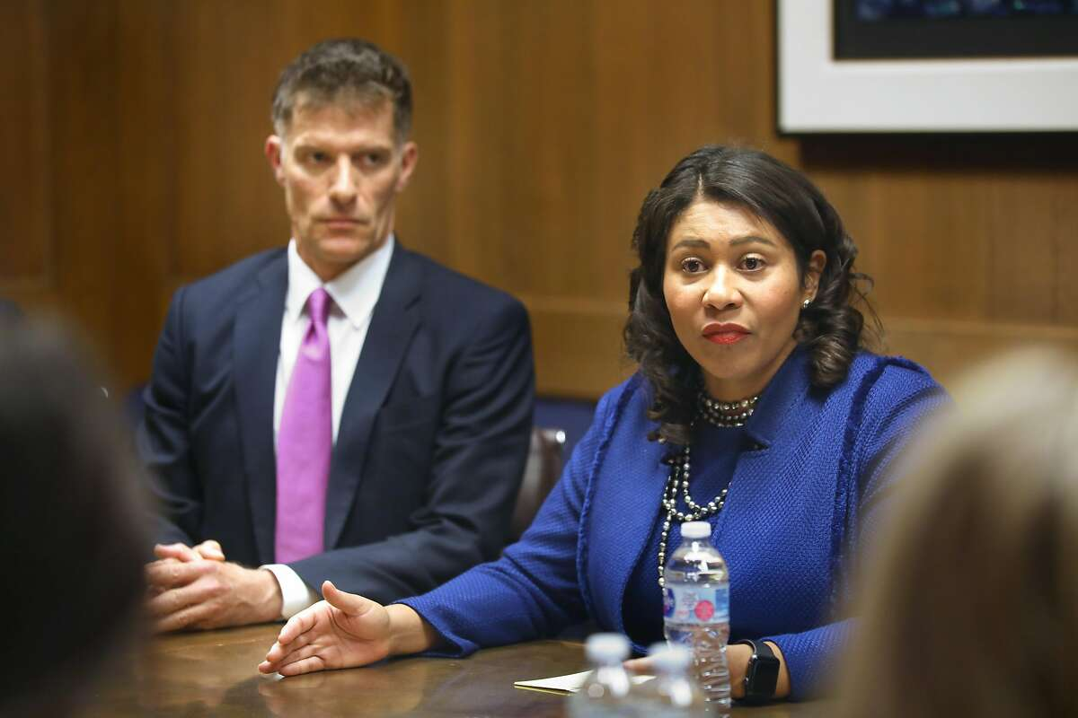 Mayor London Breed (right) including Dr. Grant Colfax (left), director of health, make an announcement about homelessness at the San Francisco Chronicle on Tuesday, Oct. 15, 2019, in San Francisco, Calif.