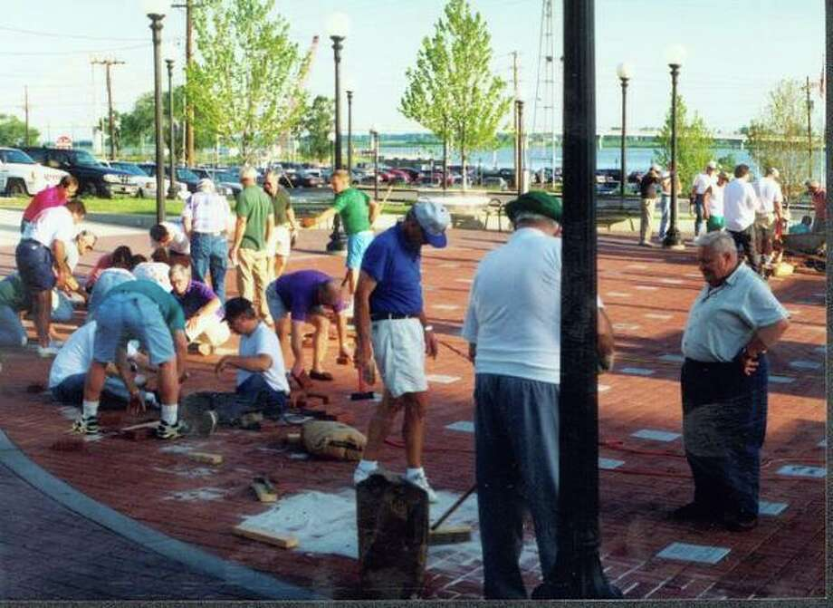 This file photo shows the Alton-Godfrey Rotary Club working at Lincoln-Douglas Square in 1994. The club was responsible for adding the last rings of brick at the Lincoln-Douglas Square.