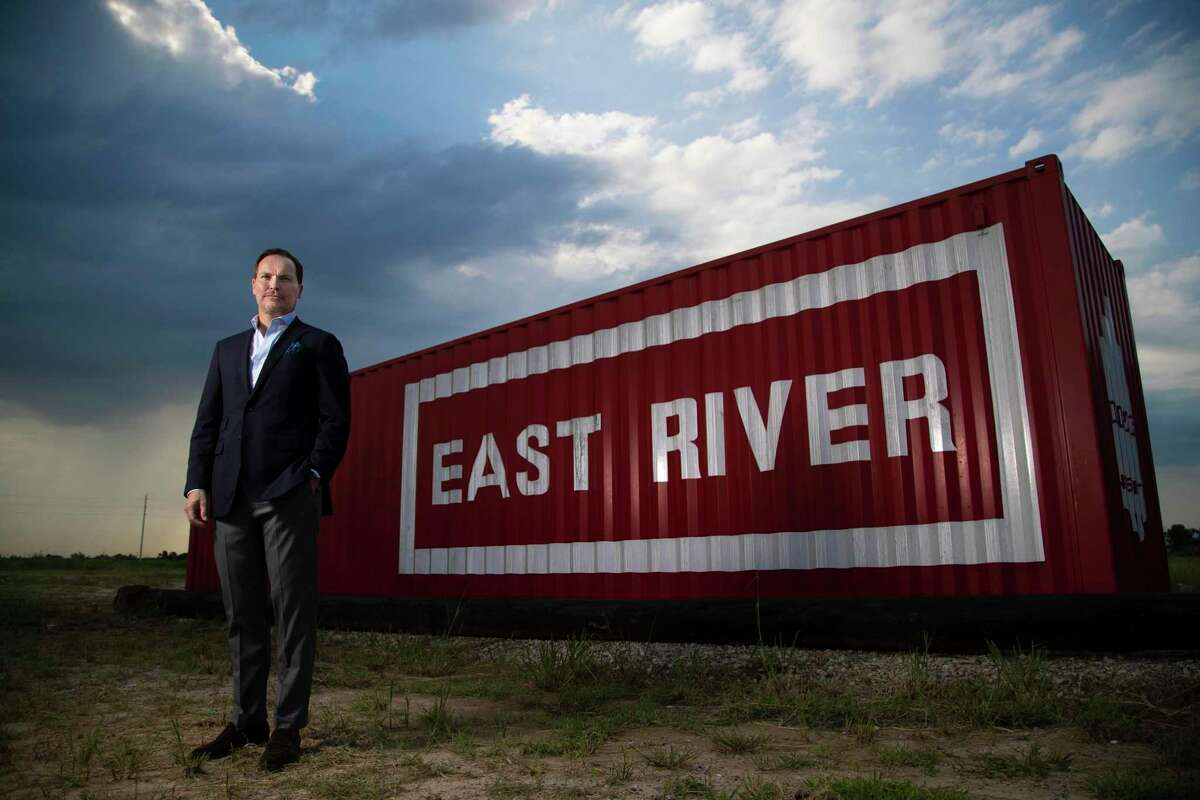 Jonathan Brinsden, CEO of Midway, poses near signage promoting his company's East River development in August 2020.
