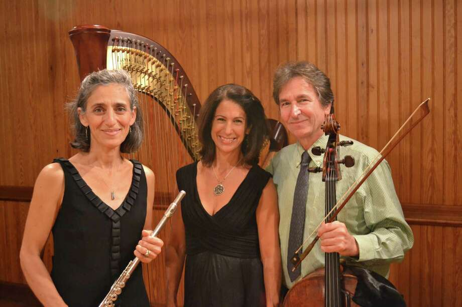 "The Sherman Chamber Ensemble will present ""The Harp's Delight"" Aug. 14 in Kent and Aug. 15 in Sherman. The program will showcase works by Impressionist composters Debussy and Ravel, plus compositions by Bach, Jongen and others. The ensemble's Artistic Director Eliot Bailen, who plays cello, right, will be joined by Susan Rotholz, left, on flute and Stacey Shame on harp. Photo: Courtesy Of Sherman Chamber Ensemble / Danbury News Times Contributed"