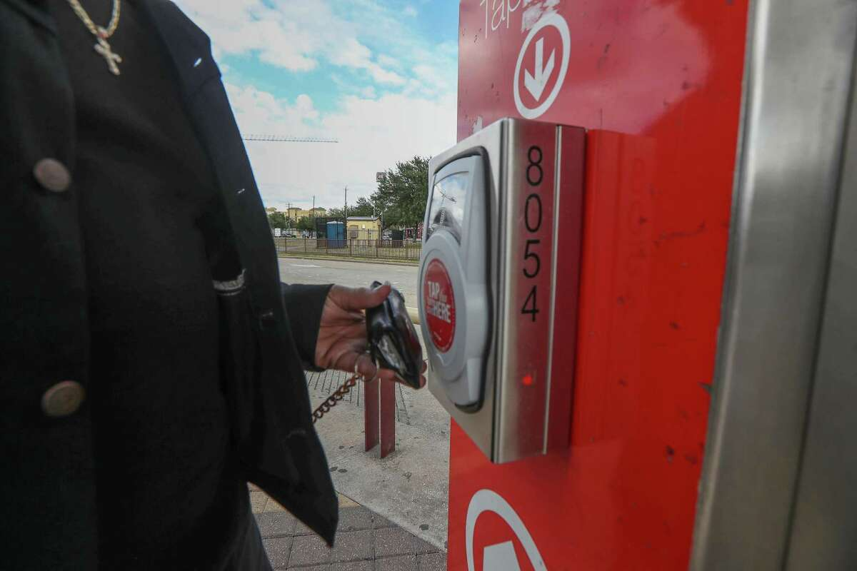 Metropolitan Transit Authority bus riders use Q cards, phone apps or cash to ride on Nov. 20, 2019, in Houston. Metro is in the early steps of revamping its fare system, which will eventually allow for payments using Apple Pay and other options.