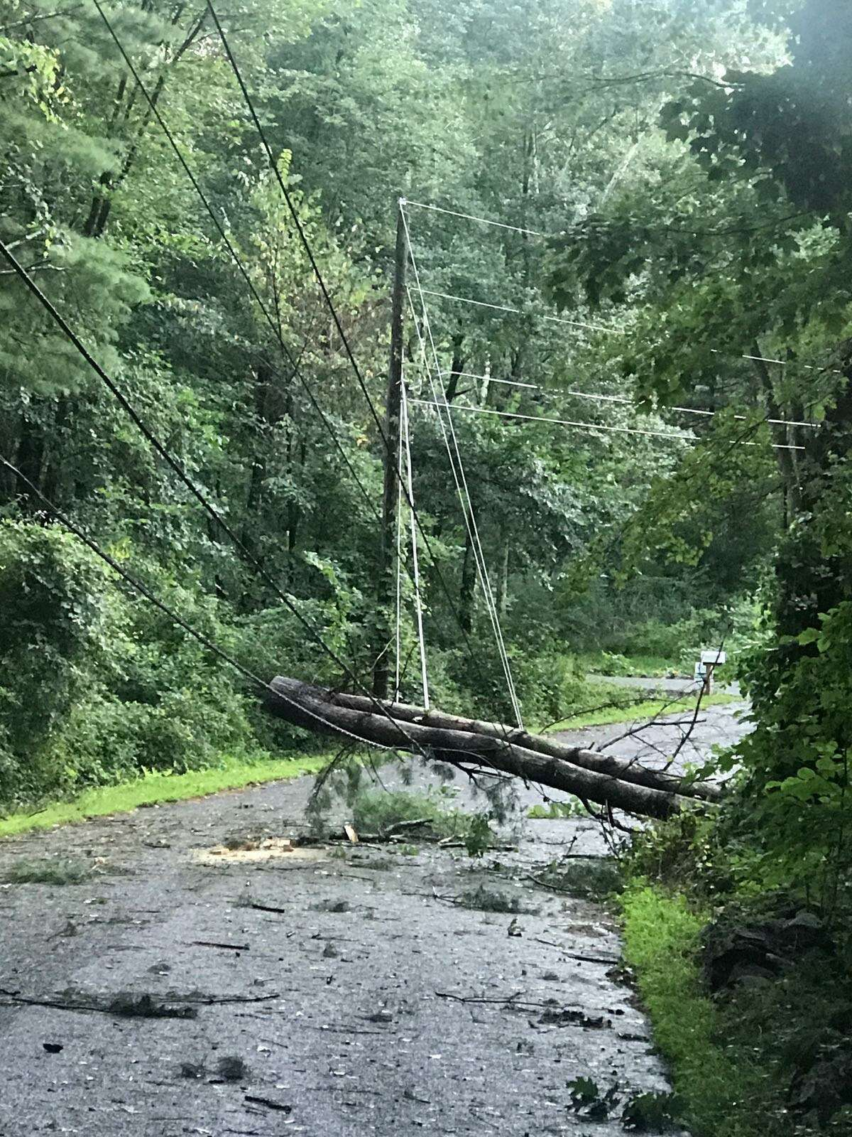 Tropical Storm Isaias wrecked havoc on much of Connecticut, including the Greater New Milford area, bringing heavy rains and winds that downed trees and power lines. Above is damage on Brinsmade Lane in Sherman.