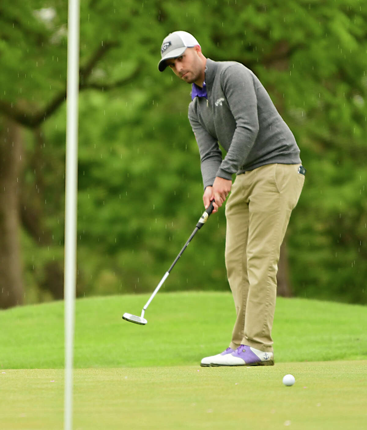 Justin Hearley of Albany watches his putt on the 18th green during the U.S. Open local qualifier at Country Club of Troy on Monday, May 13, 2019 in Troy, N.Y. (Lori Van Buren/Times Union)