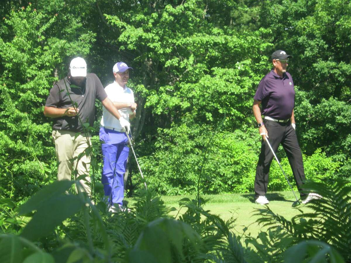 The lead pairing of (from left) Scott Berliner, Justin Hearley and Dal Daily waits on the tee Monday, June 11, 2018, during the Donald Ross Classic at the Glens Falls Country Club. (Pete Dougherty/Times Union)