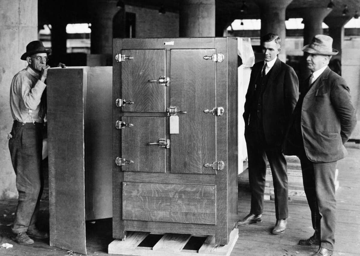 1921: Refrigerators become household appliances It got a lot easier to keep food fresh at home in the 1920s, when the refrigerator started to become an essential appliance for every kitchen. Manufacturers produced about 5,000 refrigerators in the U.S. in 1921, according to History Magazine (via The Packer). Over the next decade, another 1 million refrigerators were manufactured in the country. [Pictured: Men stand beside the first Frigidaire, made by Delco Light Company, a subsidiary of General Motors, 1921.]