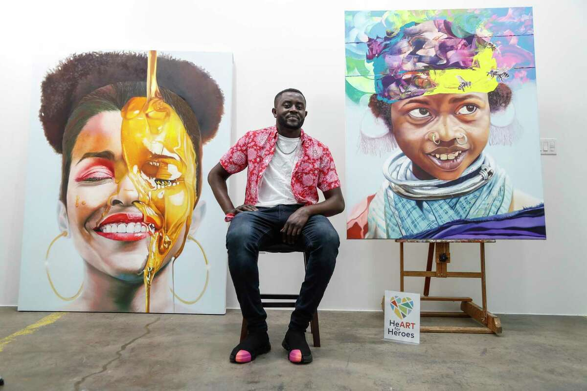Mathieu Jean Baptiste, shown in his studio with some of his artwork, is one of seven area arists taking part in the HeART for Heroes program.