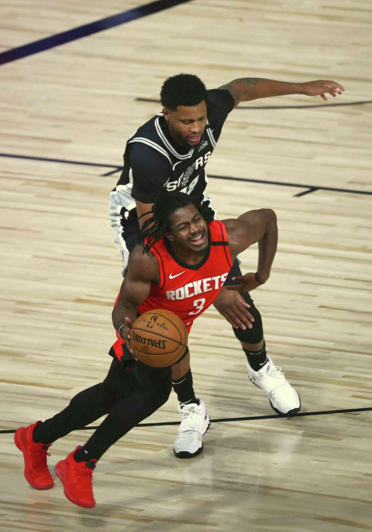 San Antonio Spurs forward Rudy Gay (22), rear, fouls Houston Rockets guard Chris Clemons (3) during the first half of a NBA basketball game Tuesday, Aug. 11, 2020, in Lake Buena Vista, Fla. (Kim Klement/Pool Photo via AP)
