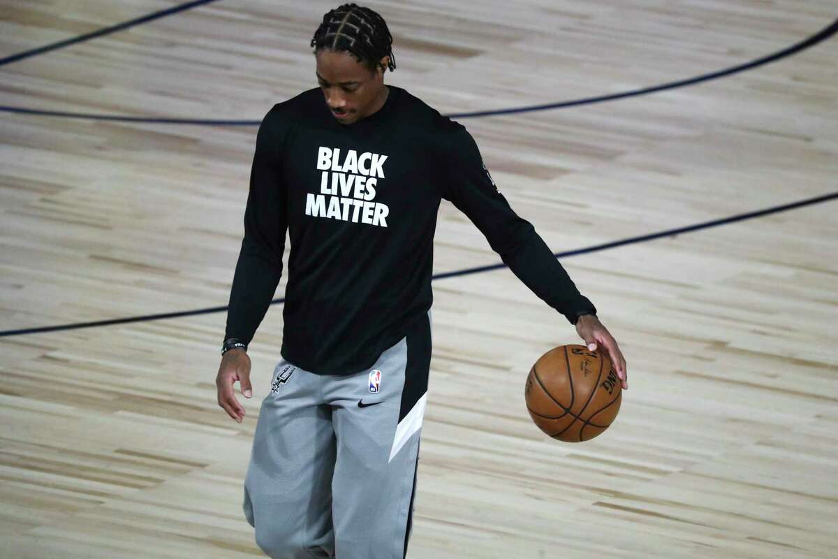 San Antonio Spurs forward DeMar DeRozan warms up before a game against the Houston Rockets on Aug. 11.