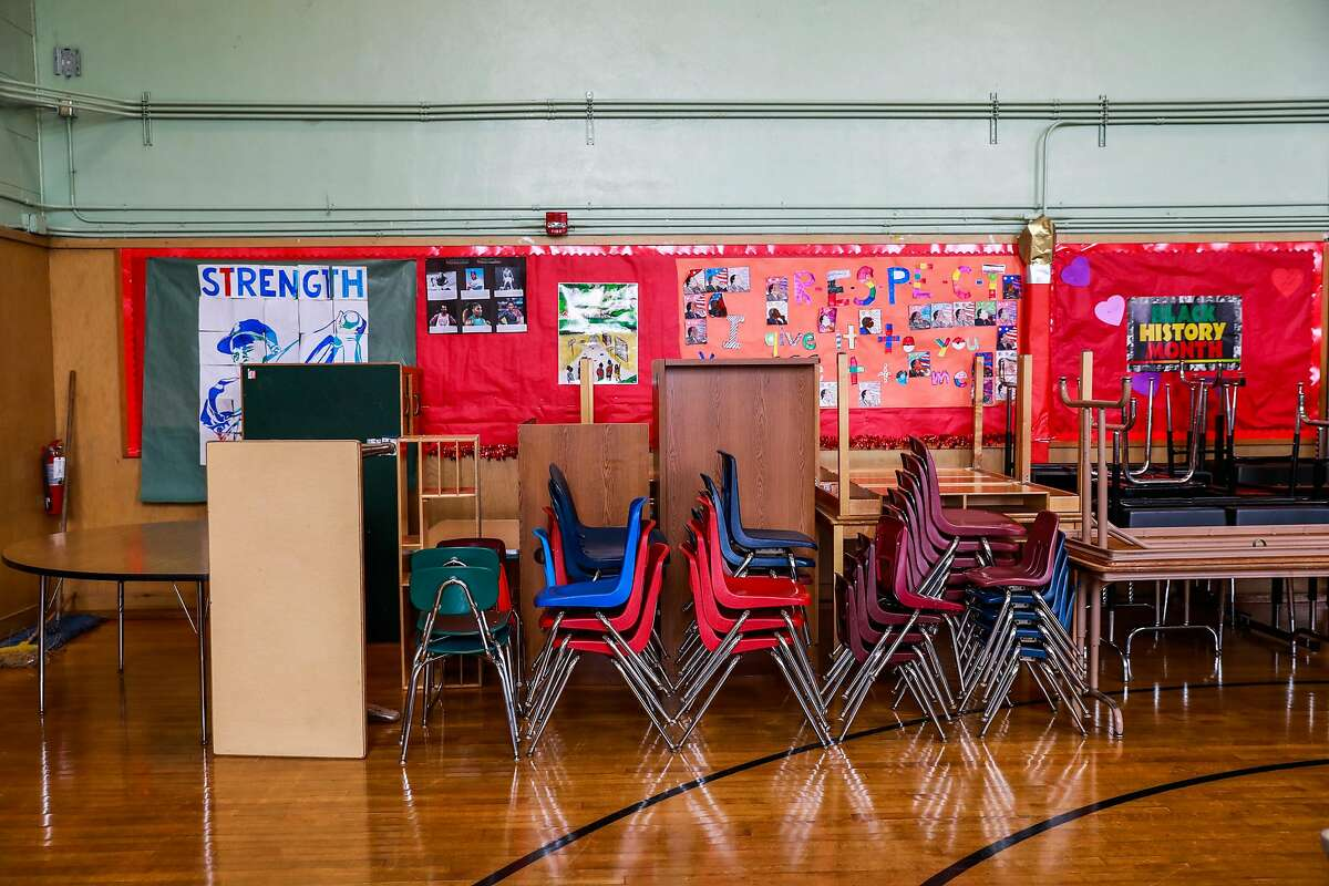 Chairs are stacked up in the assembly room at Sankofa Academy on the first day of school on Monday, Aug. 10, 2020 in Oakland, California.